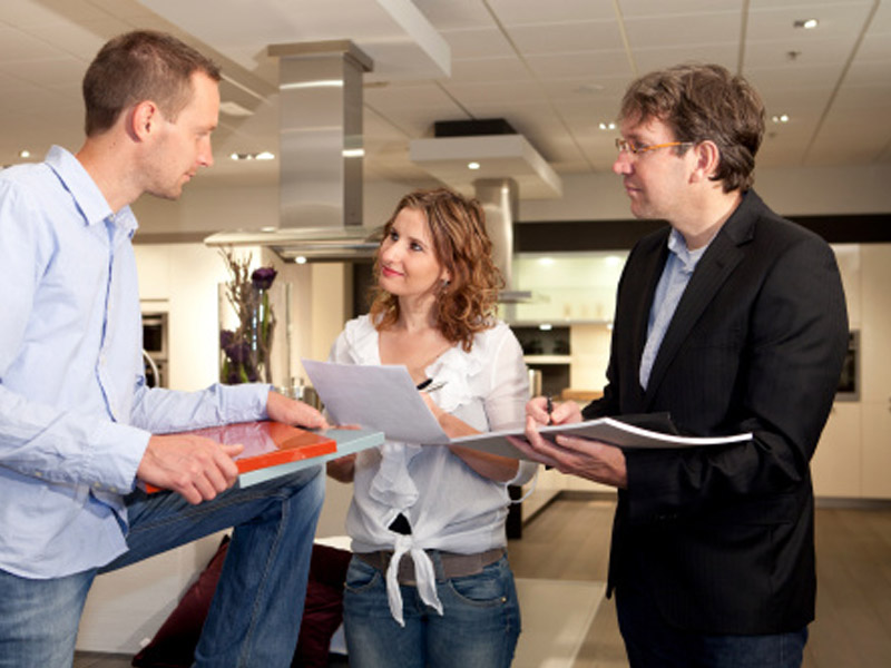 kitchen showroom designer with client